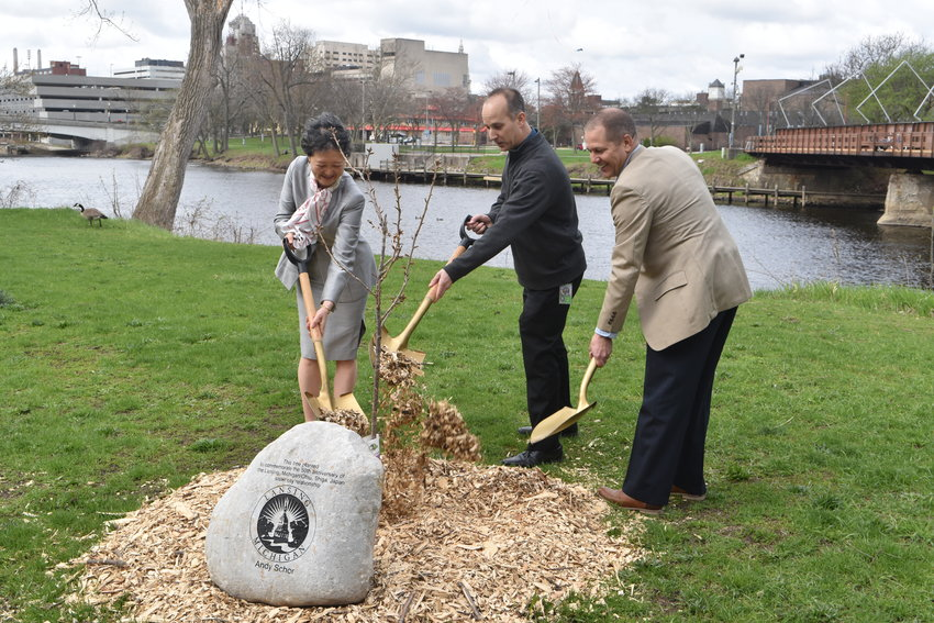 (Left to right) Deputy Consul General of the Japanese Consulate in Detroit, Yuki Sakai, Lansing Mayor Andy Schor and Lansing Parks and Recreation Director Brett Kaschinske plant a Japanese cherry blossom to commemorate the 50th anniversary if the Lansing-Otsu sister city relationship.