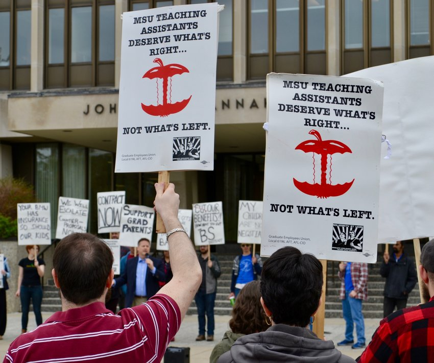Graduate students at Michigan State University rallied outside the Hannah Administration Building last week to advocate for higher wages for about 1,300 unionized teaching assistants on campus. A tentative collective bargaining agreement was struck later that afternoon.