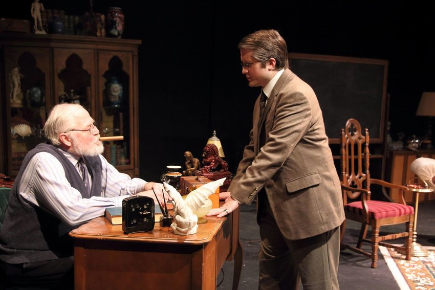 Michael Hayes (left) as Freud debating C.S. Lewis (Brian DeVries)