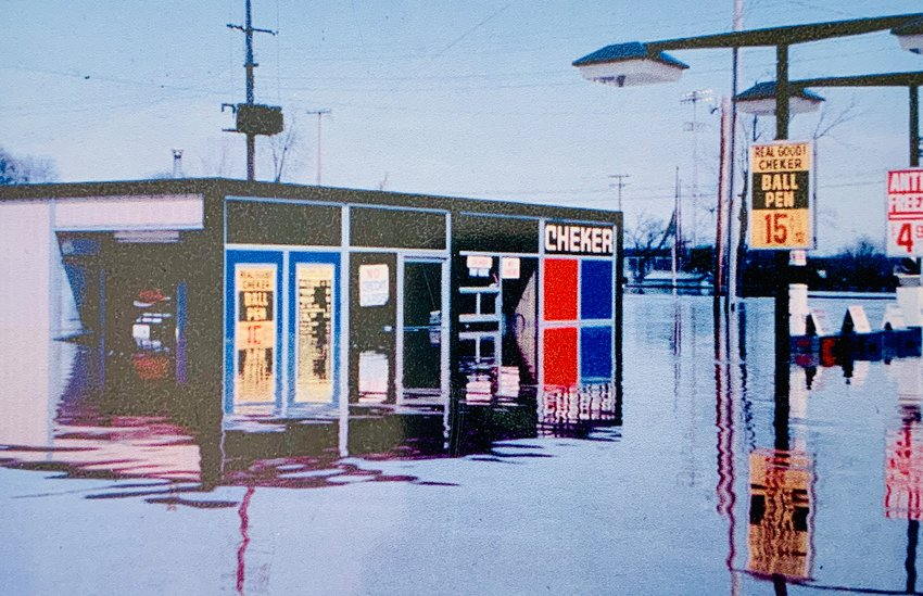 Kalamazoo Street businesses were submerged by Red Cedar River flood waters in 1975.