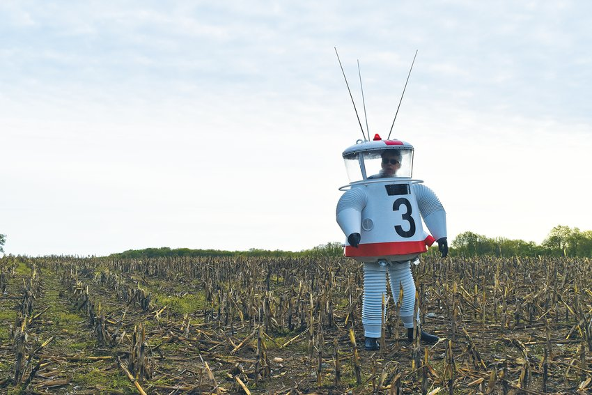 Dave Busch takes his first walk in the recreated 1962 prototype lunar explorer's suit in a cornfield in Perry.