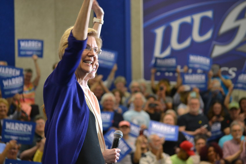 Presidential hopeful Elizabeth Warren delivered an energetic stump speech to more than 1,500 people at Lansing Community College, took three questions and then posed for pictures for over an hour.
