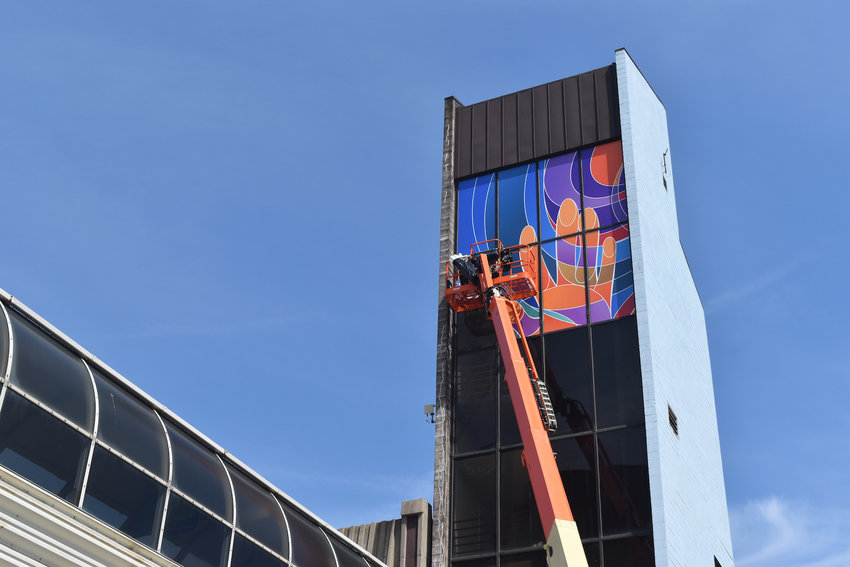 """Let Me In,"" designed by Bruce Mackley, being installed at the North Grand Ramp parking structure on Grand Avenue and Ottawa Street."