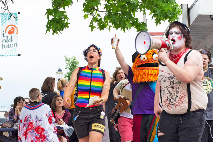 Protesters from Lansing People's Pride marched from Durant Park to Old Town to deliver a message to the nearly 6,000 patrons at the Michigan Pride Festival.