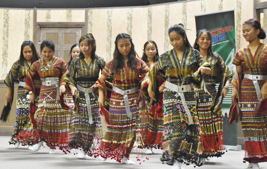 "The ""New Americans Got Talent"" show saw dancers perform in traditional garb."