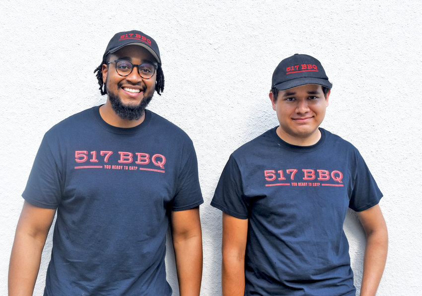 517 BBQ owner Eric McClain (left) and pitmaster Freddie Mendoza, founders of Lansing's first drive-thru barbecue restaurant.