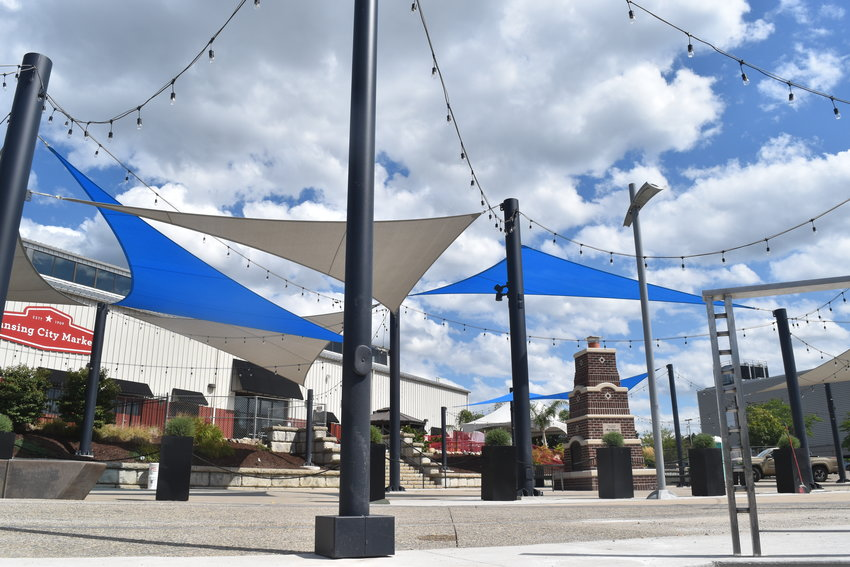 Sun sails will provide shade for future gatherings on the riverfront at the new Rotary Park in downtown Lansing.