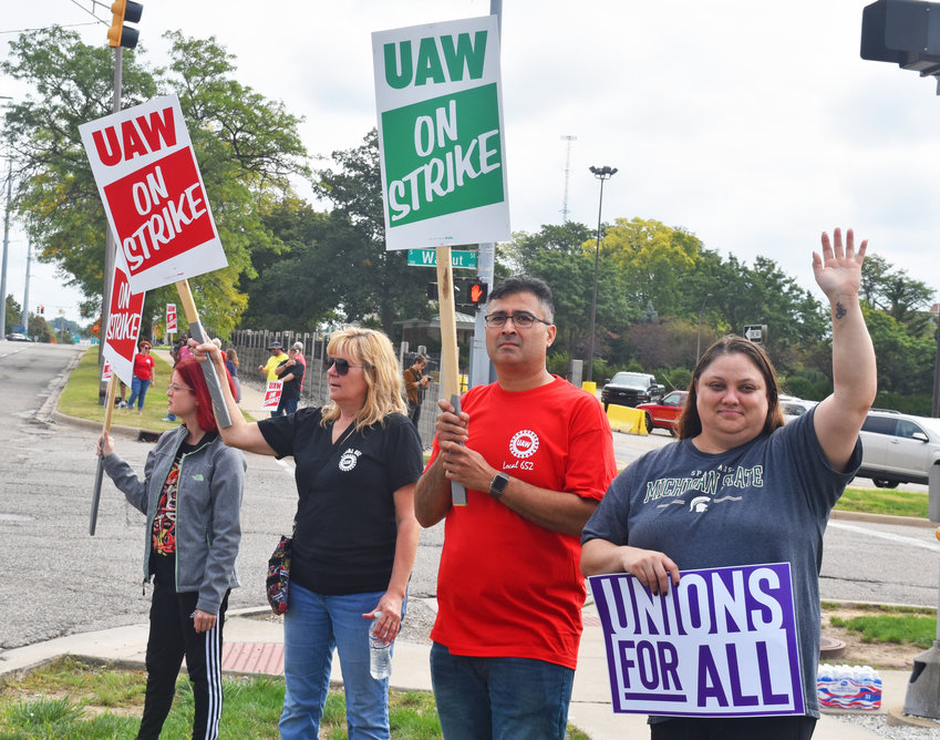 UAW protesters strike outside of Lansing's Grand River Assembly Plant.