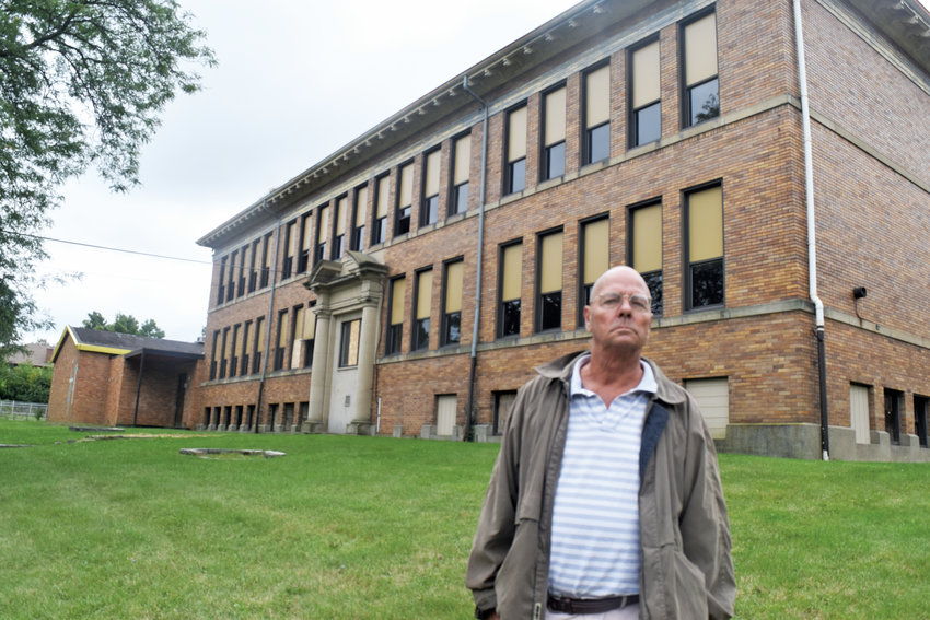 Developer Mike Markey plans to renovate Genesee Street School for use as apartments.