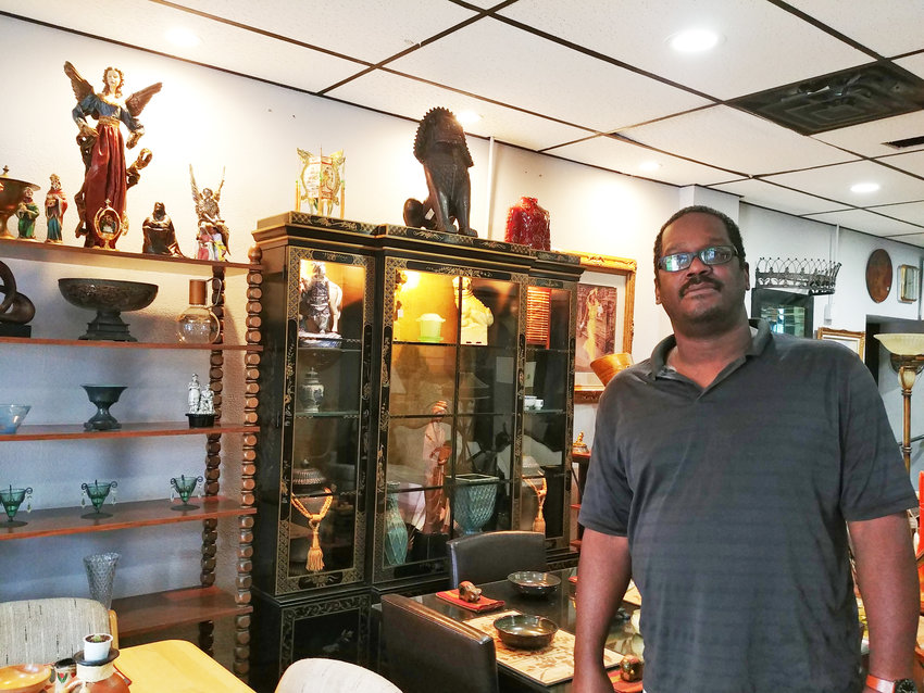 Rhea's owner Danny Buchanan collects off-the-wall furniture with character at his new south-side furniture shop.