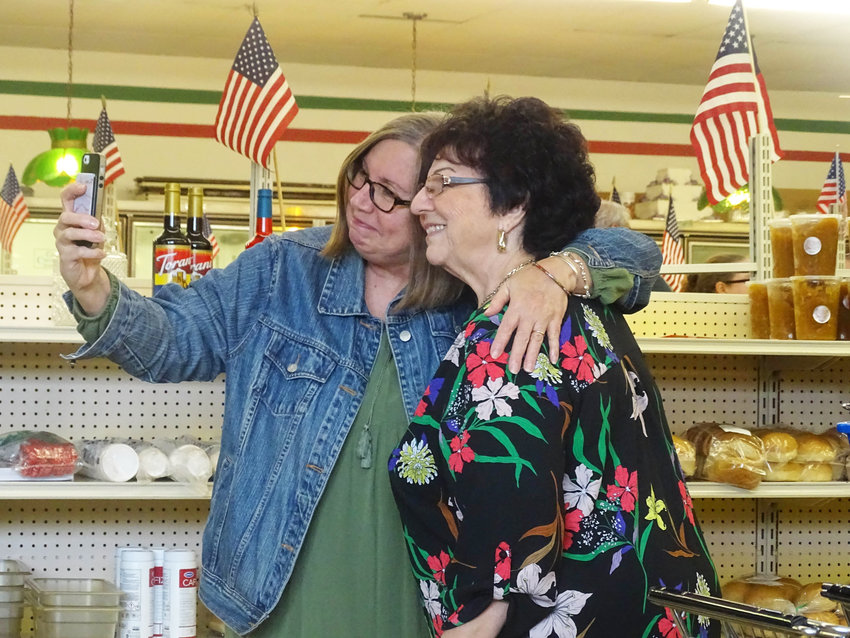 An unending stream of customers took selfies with Roma co-owner Mena Casticiano.