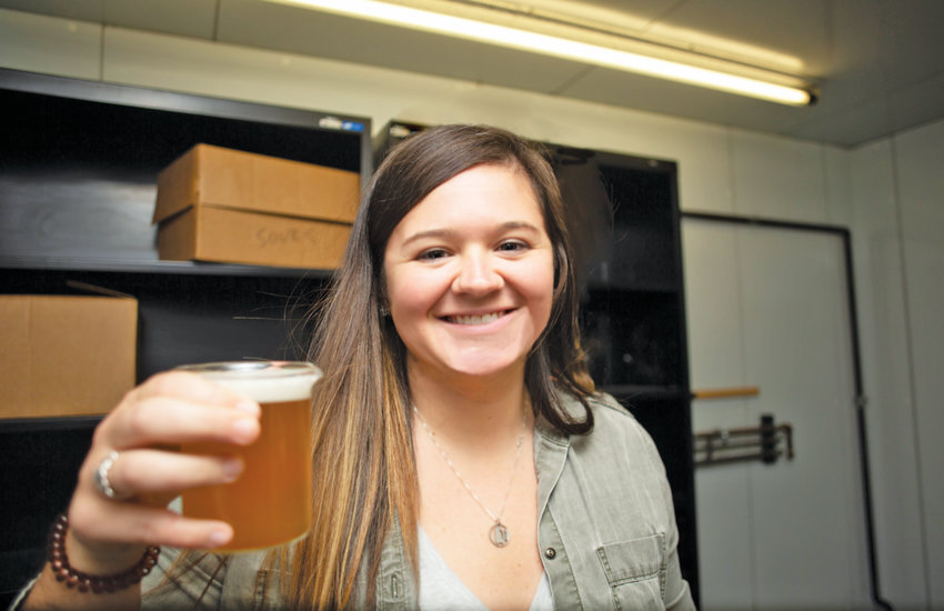 Nicole Shriner, 28, pours a sample of her first perfected craft brew recipe, which she calls ShrinerWeiss.