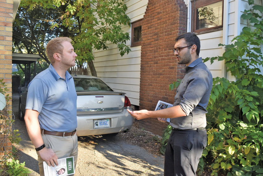 Lansing City Council candidate Brandon Betz (right) meets with a 1st Ward constituent in canvassing effort.