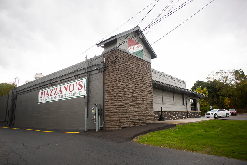 Piazzano's new look includes stone paneling and warm earth tones.