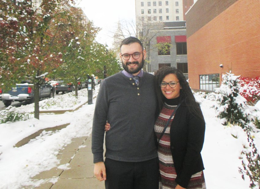Lansing Councilman-Elect Brandon Betz stands downtown with his partner, Melina Brann after winning the First Ward election.