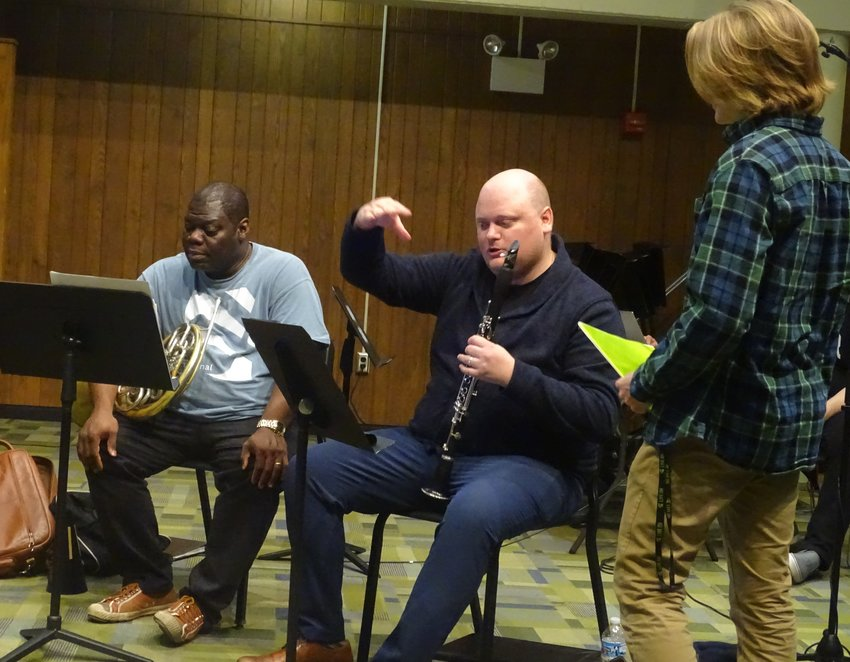 MSU composition student Jonathan Kruger gets advice from Imani Winds clarinetist Mark Dover and horn player Jeff Scott at a workshop Thursday.