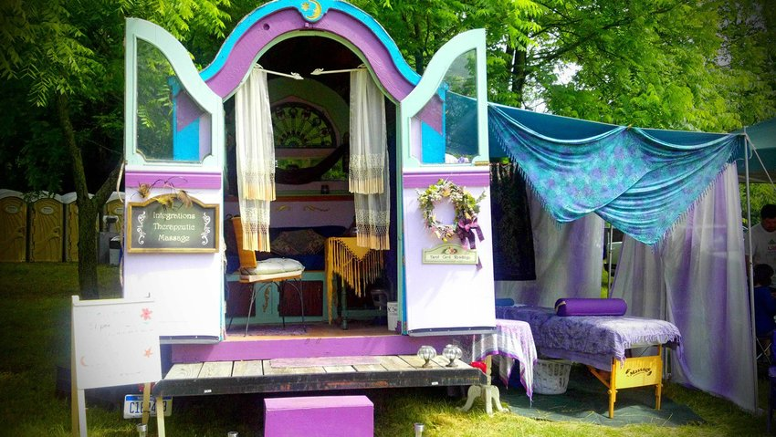 Madame Rue is known for traveling around Michigan in her handmade healing caravan named Esmeralda.