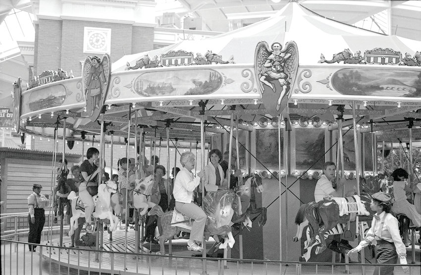 People riding the Lakeside Carousel at the opening of AutoWorld, in Flint, in 1984.