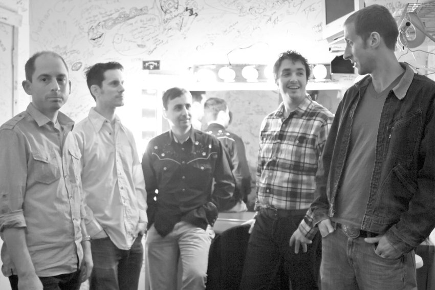 Pokes: Flatfoot, a local alt-country group led by guitarist/vocalist Aaron Bales (far right), headlines the Punks Vs Pokes concert. Other twangy acts include Old Empire and Paul Dubya & The Oak River Bridge Boys Band.