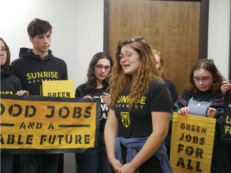 Organizers with the Lansing chapter of the national Sunrise Movement gathered yesterday at Sen. Gary Peters' Lansing office to garner support for the Green New Deal. Two were arrested and charged with trespassing.