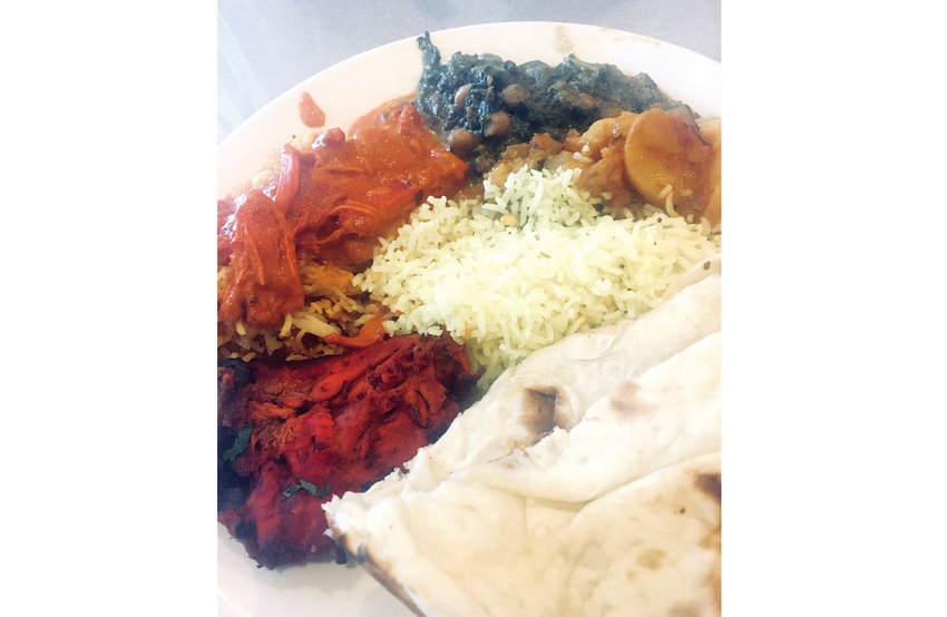 The lunch spread from Sindhu, featuring several chicken and vegetarian dishes, including Chana saag.