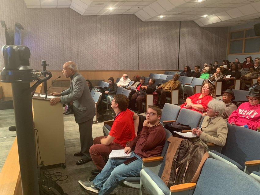 The Rev. Clyde Carnegie speaks to Lansing City Council in support of Joan Jackson Johnson on Monday night.
