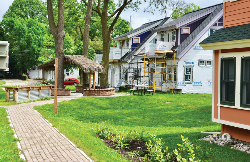 At about 1,000 square feet, the homes in developer Dave Muylle's Cottage Row on Lansing's east side are not quite tiny, but the village breaks sharply from traditional home building patterns.