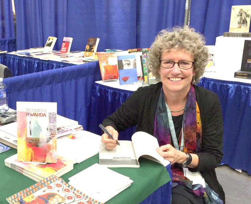 Lansing poet laureate Laura Apol.