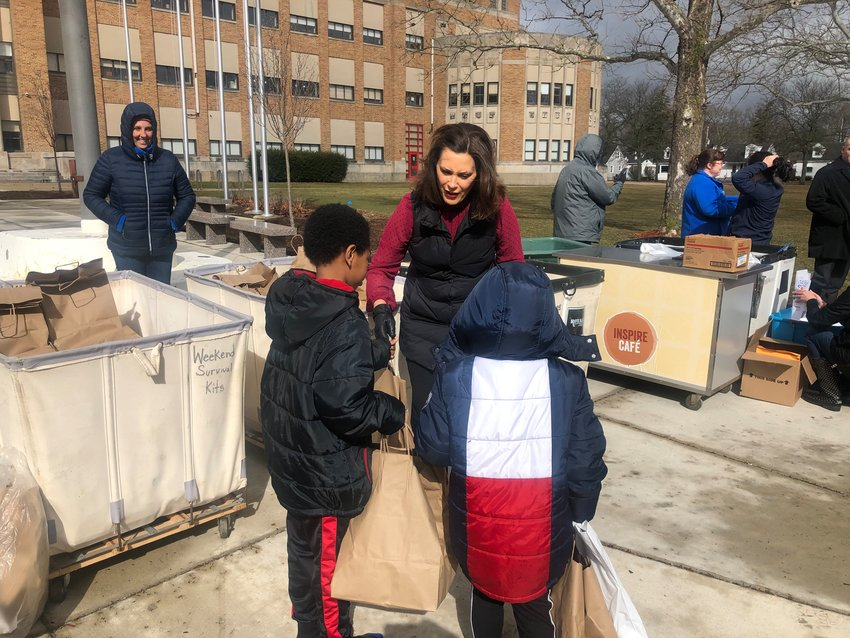 Gov. Gretchen Whitmer passed out food and school supplies earlier today at J.W. Sexton High School.