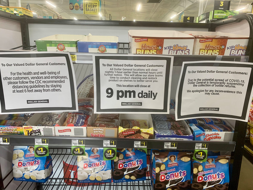 Signs posted by Dollar General.