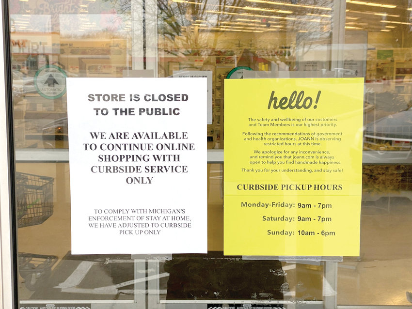Joann Fabrics and Crafts in Frandor, which was open until Tuesday. Signs on the door greeted visitors in the afternoon saying curbside delivery was still available.