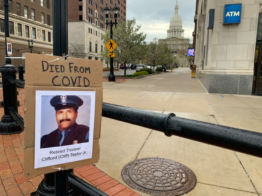 Signs posted across downtown Lansing last week paid tribute to victims of COVID-19.
