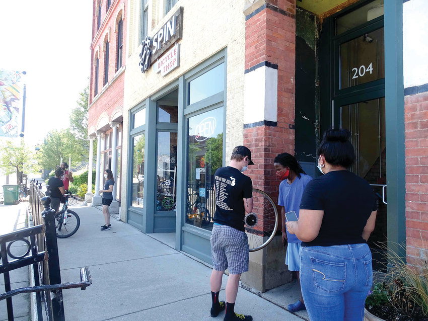 Staffers were busy helping a constant stream of socially distancing customers outside  Spin Bicycle Shop in Old Town Tuesday.