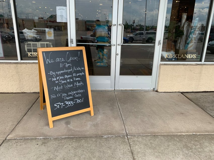 A sign outside Kirkland's home decor store in Frandor spells out the rules for customers.