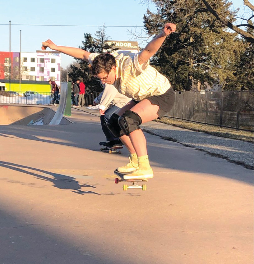 Kai Kepski, 25, pulls off an olley at Ranney Skate Park in Lansing.