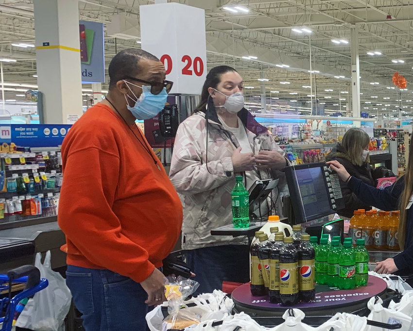 Shoppers like these at Meijer will need to keep wearing masks in supermarkets and grocery stores thru at least June 12 under an order that Gov. Gretchen Whitmer has extended.