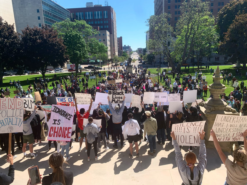Protesters kick off their march in downtown Lansing on May 31. Later, things took a violent turn.