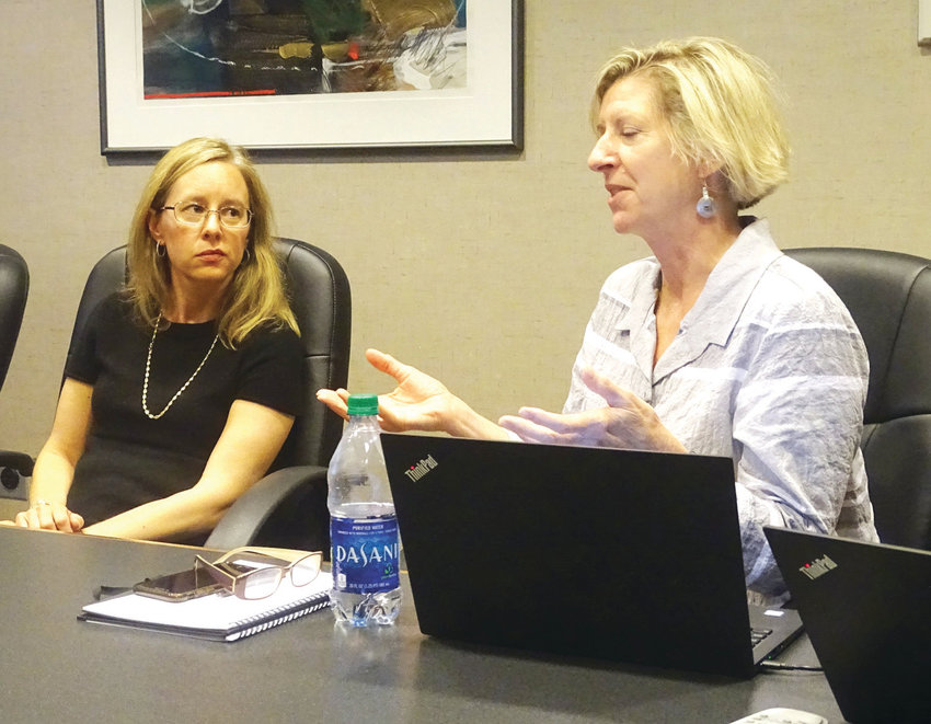 Erin Schor, chairwoman of the city of Lansing Arts Commission, listens to consultant Michele Walter (right) at a 2019 meeting. A feasibility study released in May found insufficient private funding support for the proposed $60 million facility, even before the COVID-19 outbreak.