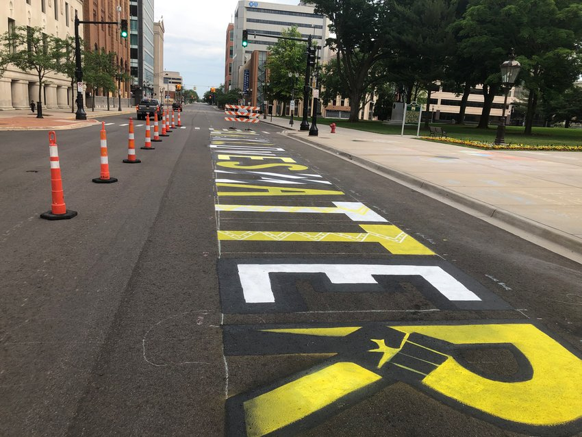 New art in town: Black Lives Matter has added lansing to the growing list of cities with street murals bearing the civil rights' group's name. This one sprang up over the weekend on Capitol Avenue in front of the Capitol.