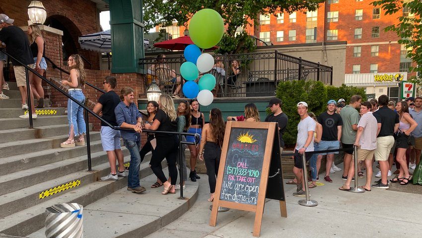 Patrons line up at Harper's Restaurant & Brewpub in East Lansing on June 8, the first day of indoor dining in Greater Lansing. As of Tuesday, 118 COVID-19 cases have been tied to Harper's.