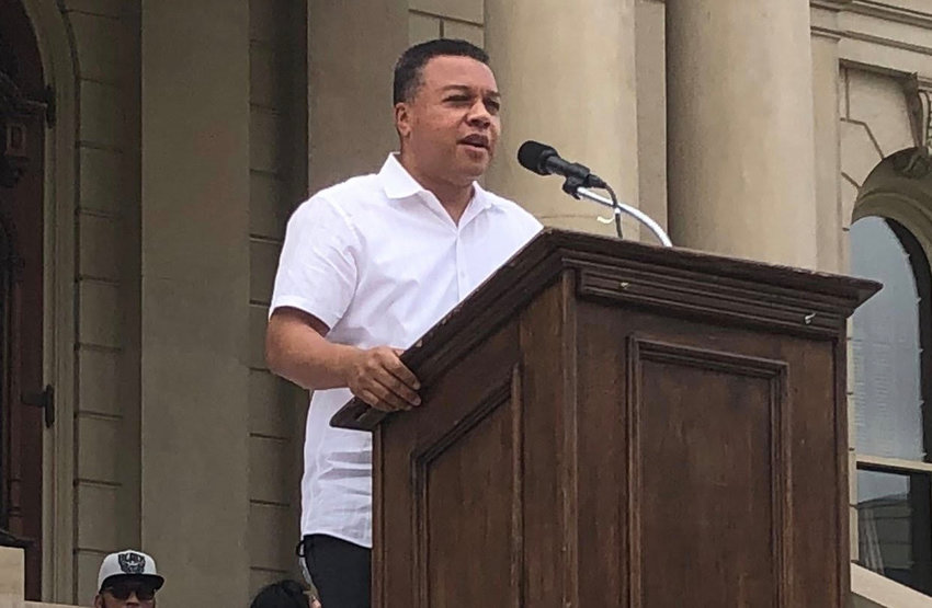Lansing Police Chief Daryl Green, pictured here speaking at a civil rights rally at the Capitol Saturday, announced today that drivers will no longer be stopped for minor violations, such as a cracked window.