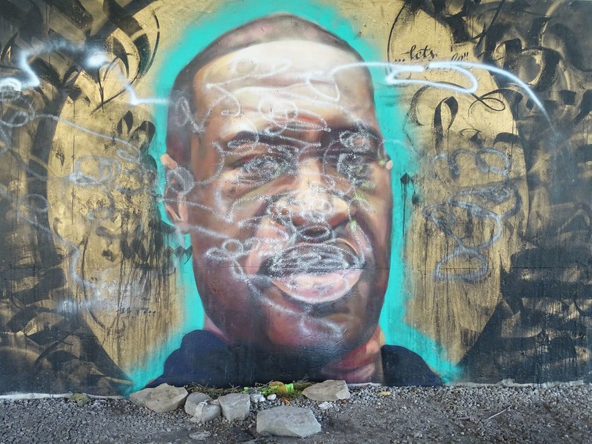 The George Floyd mural on the River Trail after it was vandalized.