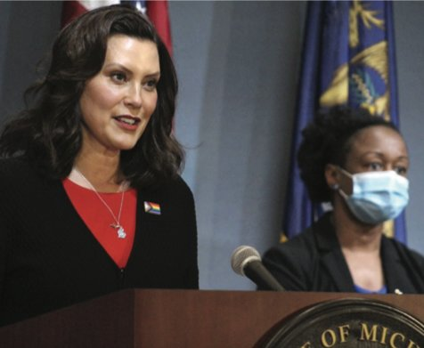 Gov. Gretchen Whitmer at a press conference in June announcing executive orders to open business.