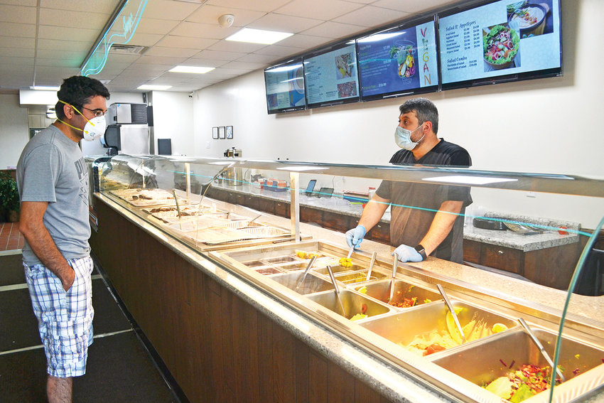 Sparty's Kabob owner Rayan Hussein takes a customer's order.