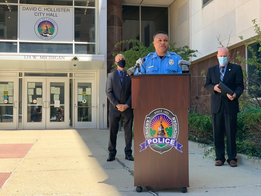 Lansing Police Chief Daryl Green, speaking at a news conference Tuesday in front of City Hall. To his left is Mayor Andy Schor.