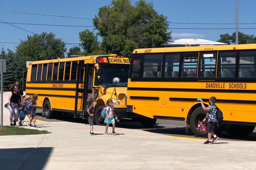 Dansville Schools students board school buses at the end of the day.