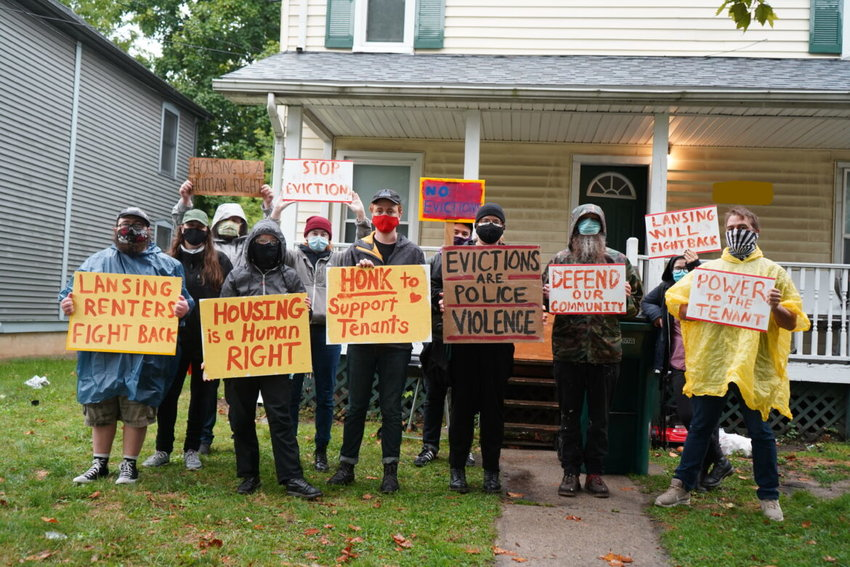 Volunteers from the Lansing Tenant Union protest recently in front of a Lansing house where a tenant is at risk of eviction. Some tenants do not qualify for protection under an eviction ban issued by the Centers for Disease Control and Prevention