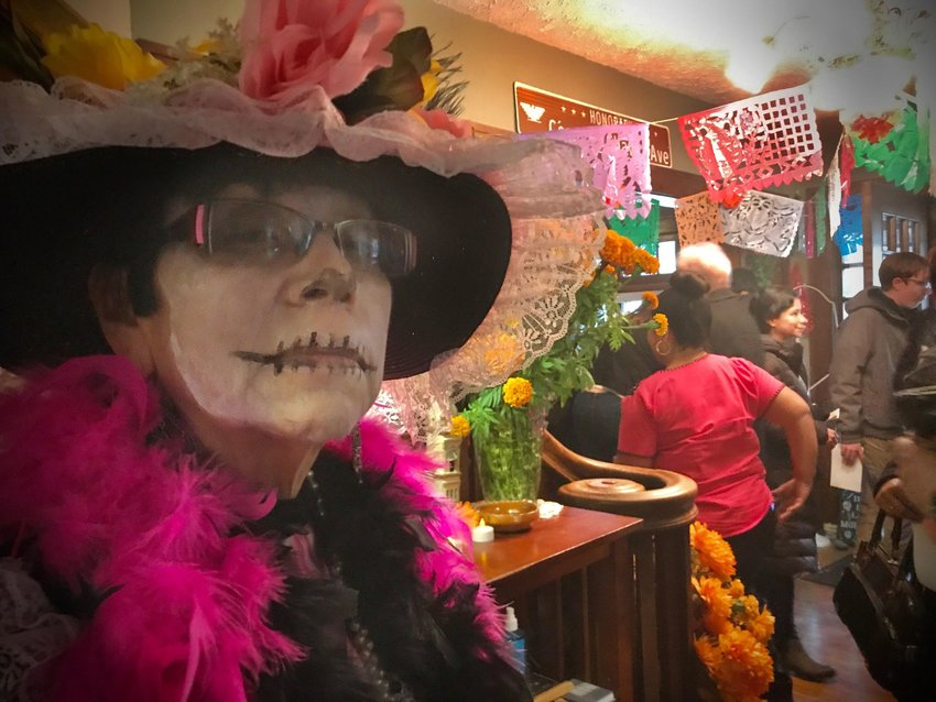 Rosa Lopez Killips dressed as a Catrina. The Mexican tradition of wearing large hats, fancy clothes and sugar skull face serve as a reminder that we do not carry our wealth with us when passing. One of the ofrendas nominated by the Dia de Los Muertos Advisory Committee honors the life of Rosa who passed away this year. Rosa organized decades of Dia de Los Muertos celebrations in Lansing.