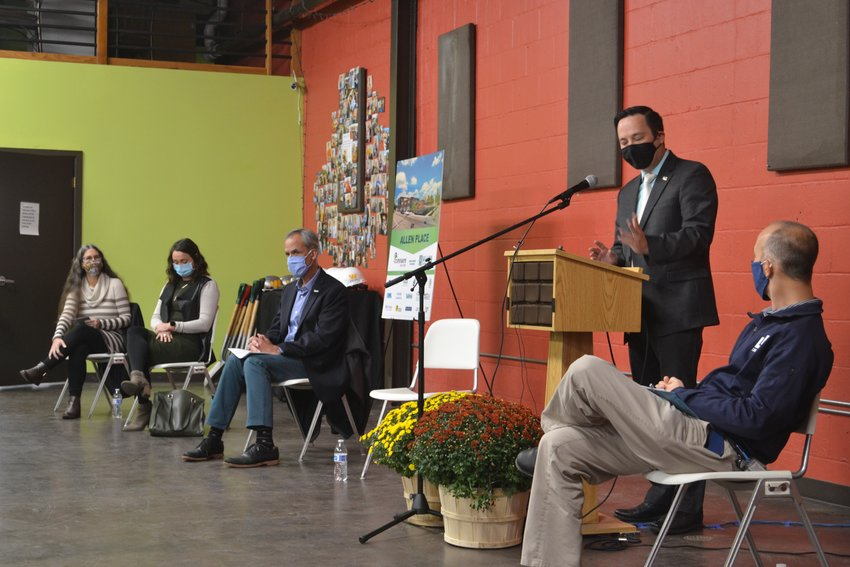 Jonathan Lum, president of the Allen Neighborhood Center Board of Directors, speaks at Allen Neighborhood Center's Allen Place groundbreaking ceremony. Other speakers included Mayor Andy Schor, Marilyn Crowley, Mark McDaniel, Bob Tresize, Steve Opper, Jose Aste and Jennifer Grau.