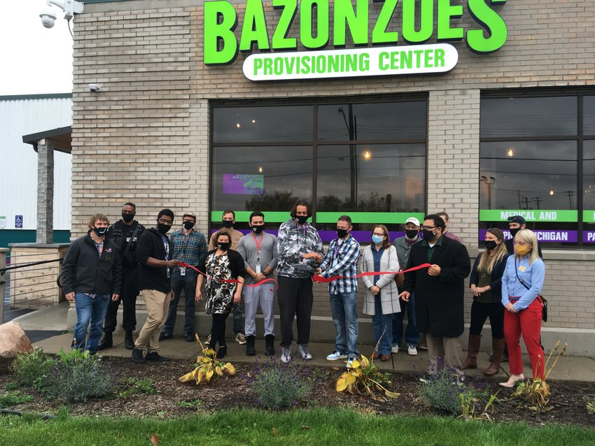 Employees of Bazonzoes Provisioning Center at 2101 W. Willow Highway in Lansing celebrated the business opening with a ribbon cutting today.